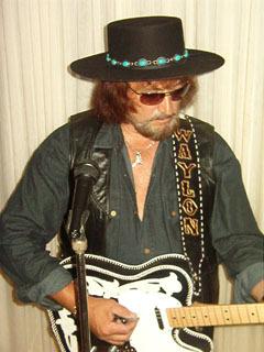 Bob Gill as Waylon Jennings